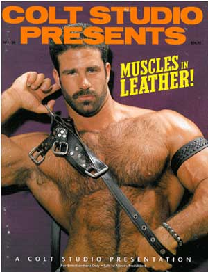 Muscles in Leather Colt studios, vintage gay porn magazine,  big muscle hunk hairy chest leather harness