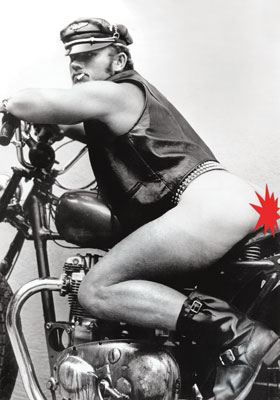 hunky macho gay leather stud on a motorcycle