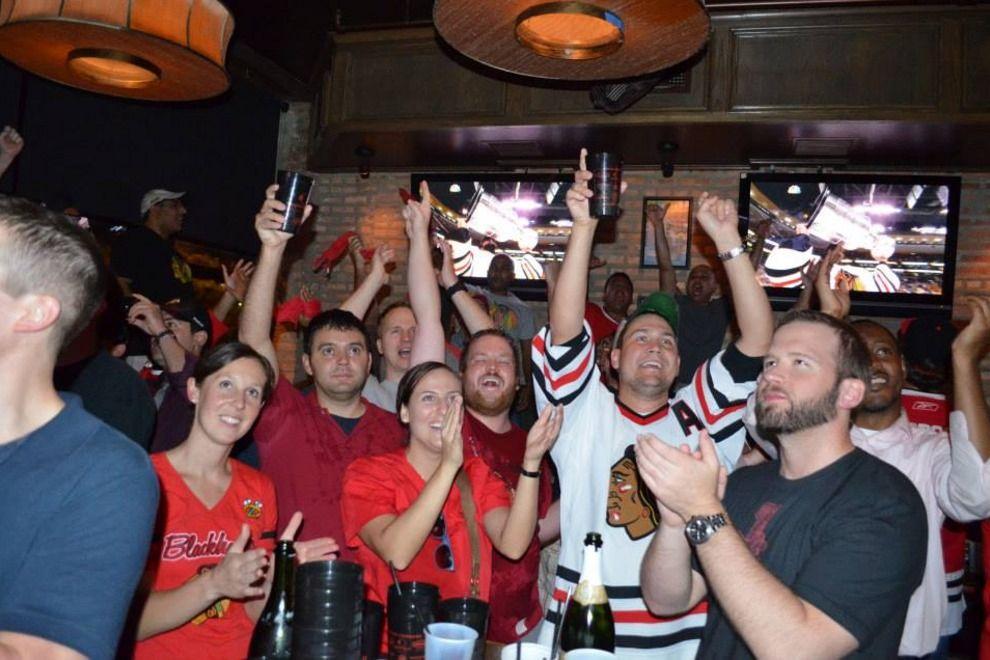 Bros cheering at a sports bar