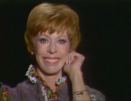 Carol Burnett tugging her ear