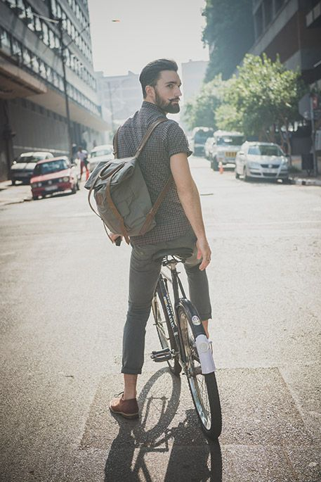Bearded hipster guy on bicycle