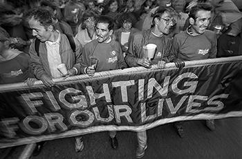 AIDS activists hodling banner that says Fighting for Our Lives