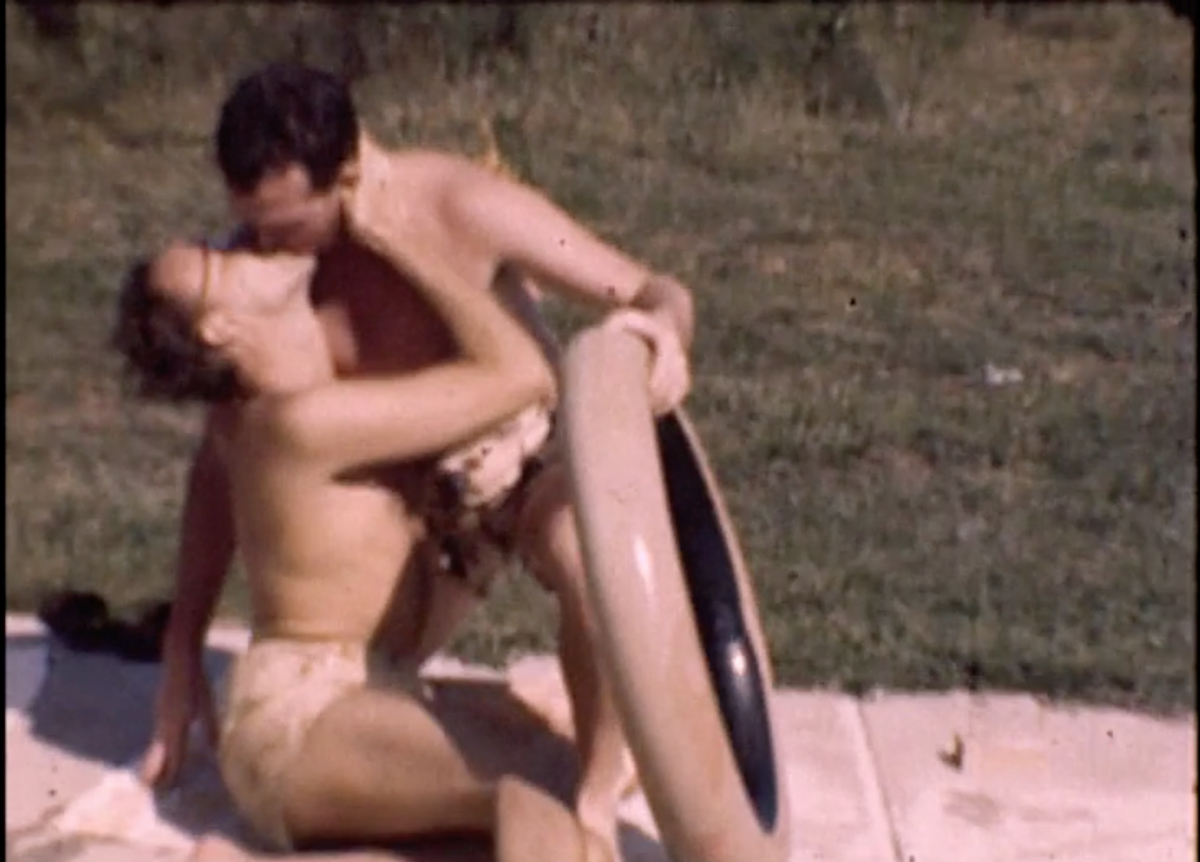 Men kissing at 1940s gay pool party