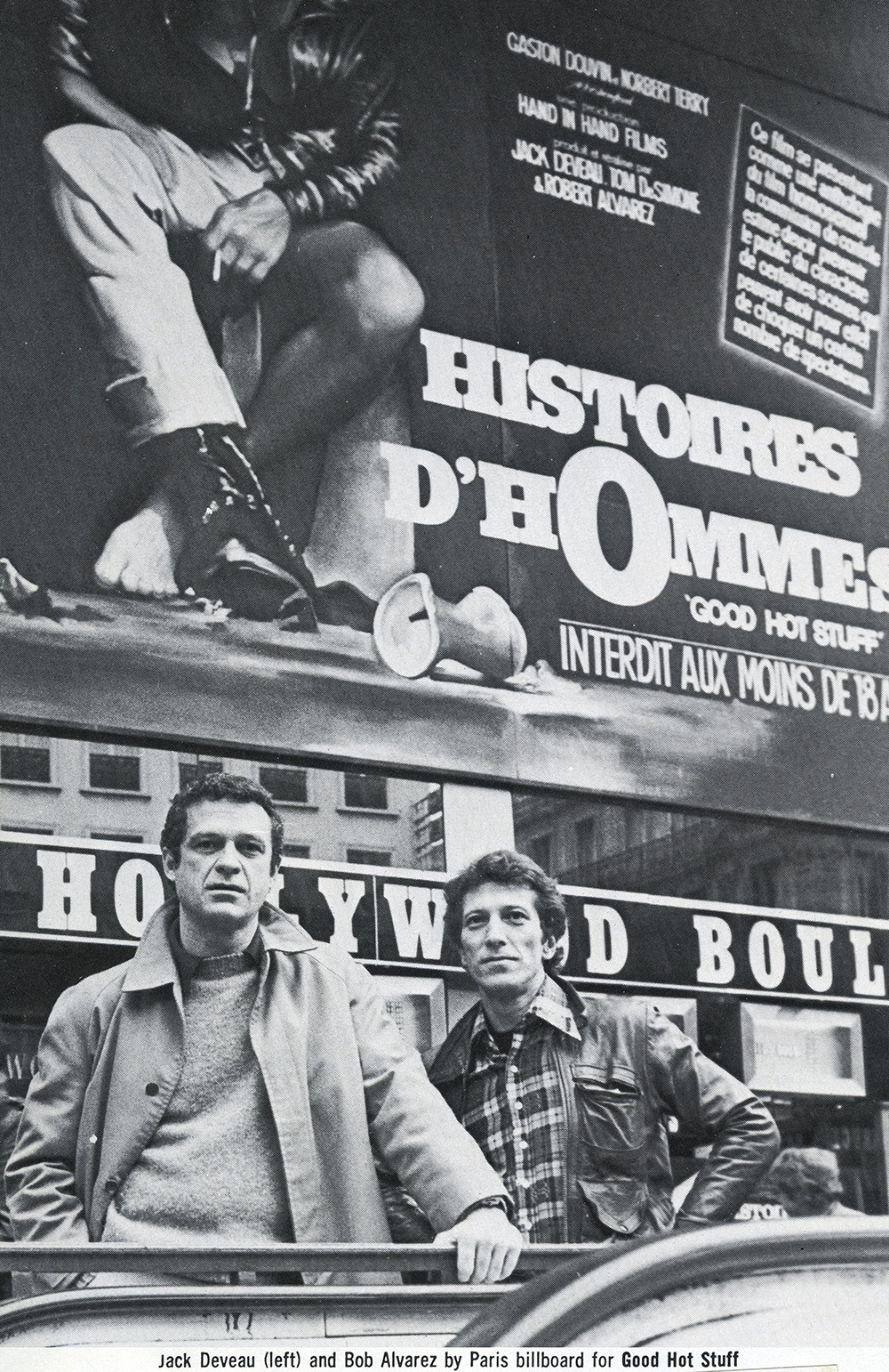 Jack and Robert Alvarez in front of a Histoires d'Hommes billboard in Paris