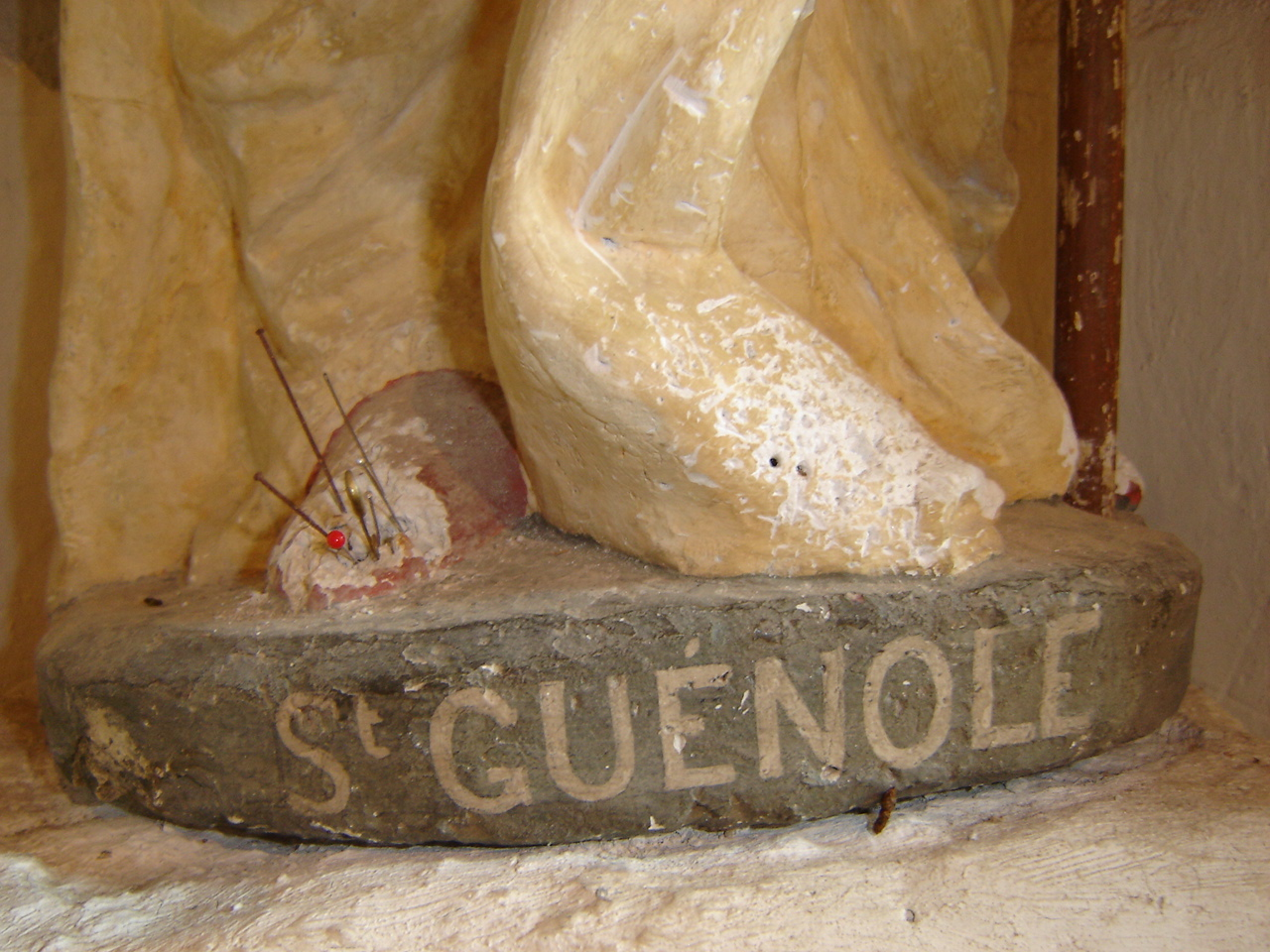 Statue of Saint Guignole pierced with needles