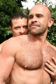 Man grabbing another man's hairy chest
